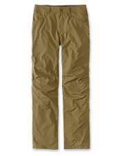 Five-pocket styling imparts versatility to these rugged nylon adventure pants.