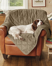 Grip-tight mesh under this cozy quilted dog throw helps it stay where you put it.