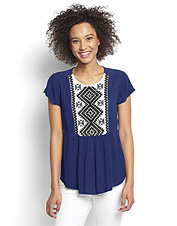 This distinctive embroidered rayon gauze blouse spotlights Native American-inspired designs.