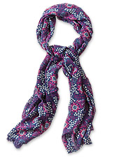 The dramatic pattern on this luxe blend scarf makes a lovely statement with your outfit.