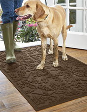 An oak leaf motif decorates this rugged, mud-grabbing Recycled Water Trapper Mat.