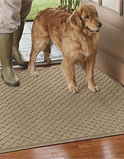 This Basketweave Recycled Water Trapper Mat ensures dirt and mud won't make it past the door.