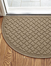 Keep dirt off your clean floors with the Basketweave Recycled Water Trapper Half Moon Mat.