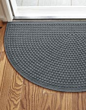 Use the Grid Recycled Water Trapper Half Moon Mat to keep mud, dirt, and snow off your floors.