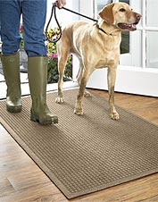 Dirt and moisture stop at the door with our Grid Recycled Water Trapper Mat on the job.