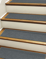 These grippy Recycled Water Trapper Grid Stair Treads shed dirt on basement or porch steps.