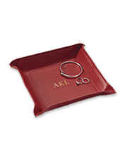 Keep up with your small things in style in this packable, personalized leather jewelry tray.