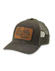 A waxed cotton bill and front panel give this retro trucker cap a water-repelling advantage.