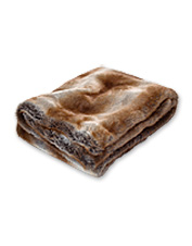 Bring apres-ski to your living area with our exceptionally soft Faux-Fur Throw blanket.