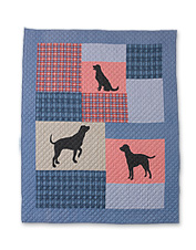 Bring a pack of capering canines into any room with this cozy, reversible Quilted Dog Throw.