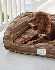 The Orvis ComfortFill-Eco™ Bolster Dog Bed gets refreshed with weather-resistant Sunbrella fabric.