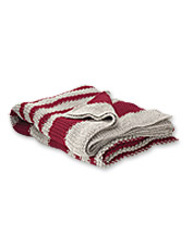 Wrap up in this striped chunky knit throw for a relaxing retreat at the end of the day.