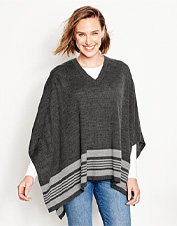 The elegance of a perfectly draped poncho spans seasons in our Signature merino wool version.
