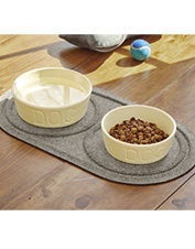 Protect your floors and keep dog bowls in place with this Water Trapper mat made for mealtime.