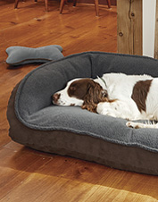 A plush fleece sleep surface adds indulgent softness to our ComfortFill-Eco Bolster Dog Bed.