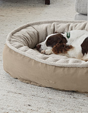 A cozy, soft fleece sleep surface tops this durable ComfortFill-Eco Wraparound Dog Bed.