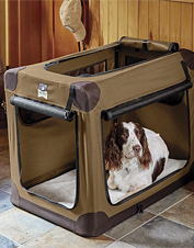 The handsome Orvis Field Collection Folding Travel Crate is a cozy portable den for your dog.