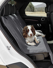 Grip-Tight backing ensures this backseat protector won't slip, and Sherpa keeps your dog cozy.