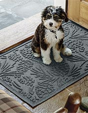 Bring a laid-back cabin feel to your home with this pinecone-motif Recycled Water Trapper Mat.