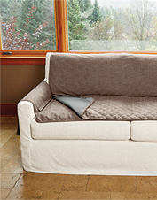 Our Grip-Tight Furniture Protector refuses to budge, and the removable pad makes cleanup easy.