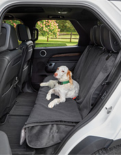 Zip off the reversible pad on our backseat protector to refresh the dog's seat between washes.