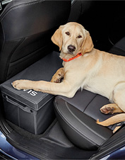 Let your dog stretch comfortably in the backseat—this seat extender includes storage space.