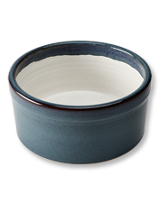 This Handmade Stoneware Dog Bowl stays put during meals for even the most enthusiastic eaters.