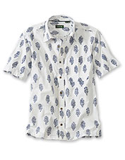 An artisan-created batik print stands out against the fresh white background of this shirt.