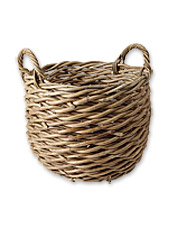 The natural, handwoven design of this round Rattan Basket is a welcome addition to any room.