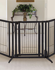 Keep off-limits spaces pet-free with the walk-through Premium Plus Freestanding Dog Gate.
