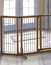 Keep your dog safe behind the adjustable Premium Plus Freestanding Pet Gate for wide openings.