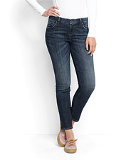 These Stretch Denim Ankle Boyfriend Jeans spotlight an ankle-length cut and looser fit.