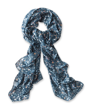 Watercolor florals meet a jacquard weave in this pretty scarf that adds texture to any look.