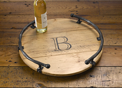 Bring rustic elegance to the table with this personalized wooden lazy Susan edged with iron.