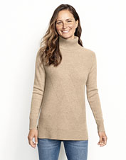 Attain perfect cold-weather comfort with our cozy cashmere turtleneck in a tunic silhouette.