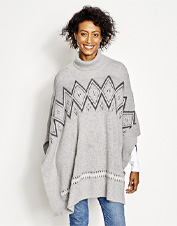 The warmth of wool and softness of cashmere meld in the polished Fair Isle Turtleneck Poncho.