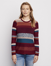 The variety of textures and rich hues in our Mixed Stripe Roll Neck Sweater garner attention.