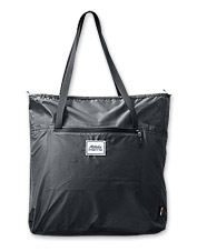 Compact when tucked away, the Transit Packable Tote by Matador expands to carry travel finds.