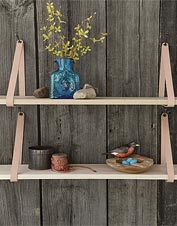 Hang these suspended wooden shelves from the rugged leather straps for an instant rustic feel.