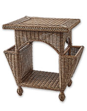 This indoor wicker side table is a bucolic accent with plenty of space for reading materials.