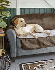 Protect your furniture in style with a dog couch cover made from faux leather and cozy fleece.