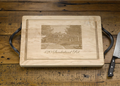 This etched cutting board can be personalized with an image of your house or other photo.