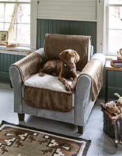 Cover your dog's favorite seat with this non-slip Faux Leather and Fleece Chair Protector.