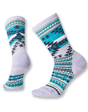 Premium Potlach Crew Socks by Smartwool and CHUP are toasty warm and cushioned for support.