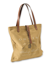 A vintage-look crossed rods motif is printed on this rugged canvas and leather tote.