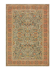 Rich, earthy hues create a vintage look in this refined Kamet area rug.