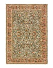 Rich, earthy hues create a vintage look in this refined Kamet area rug.