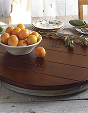 Put this wine barrel Lazy Susan on your tabletop to organize your dining needs. Made in USA.