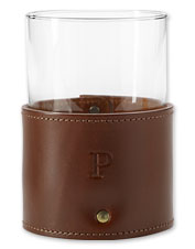 This elegant set of four leather-wrapped drinking glasses elevates casual occasions.