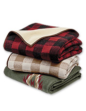 Warm up around the fire with our fleece throw.